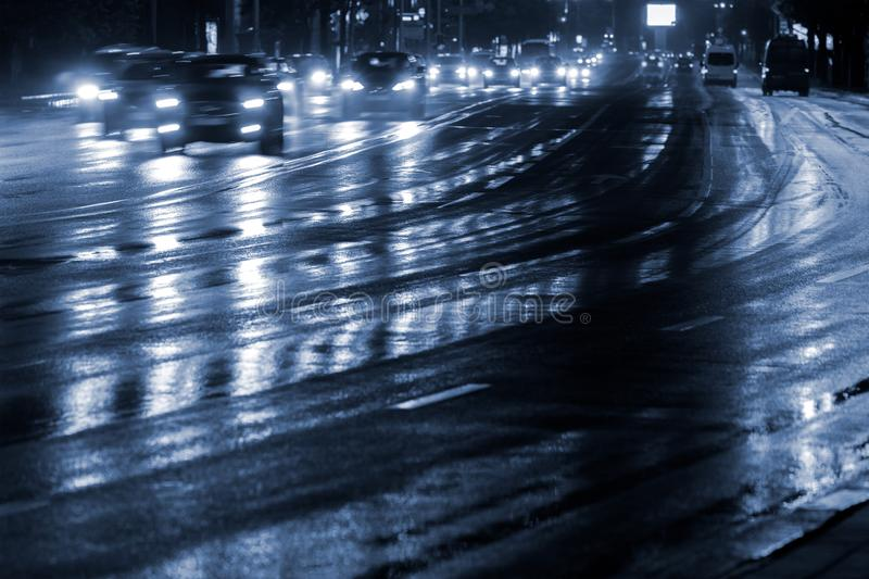 Car lights reflecting in wet road after rain. blurred motion. royalty free stock photos