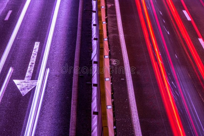 Car lights in the road stock photo