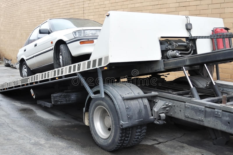 Car loaded on tow truck stock photo