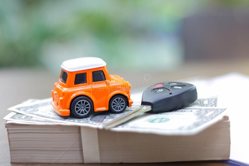 Car loan application with car keys and model car. Car loan application with car key and model car stock images