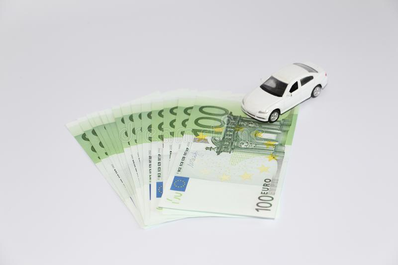 Car loan. Car on the background of currency. Money can be taken in the bank royalty free stock images