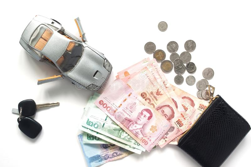 Car loan or financial with Thai banknotes currency, top view on. White background stock images