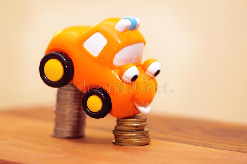 Car Loan. Car Insurance. Finance concept. Car Over Declining Stacked Coins. royalty free stock images