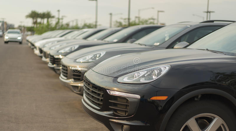 Car lot - sales auto dealership. Shallow depth of field stock images