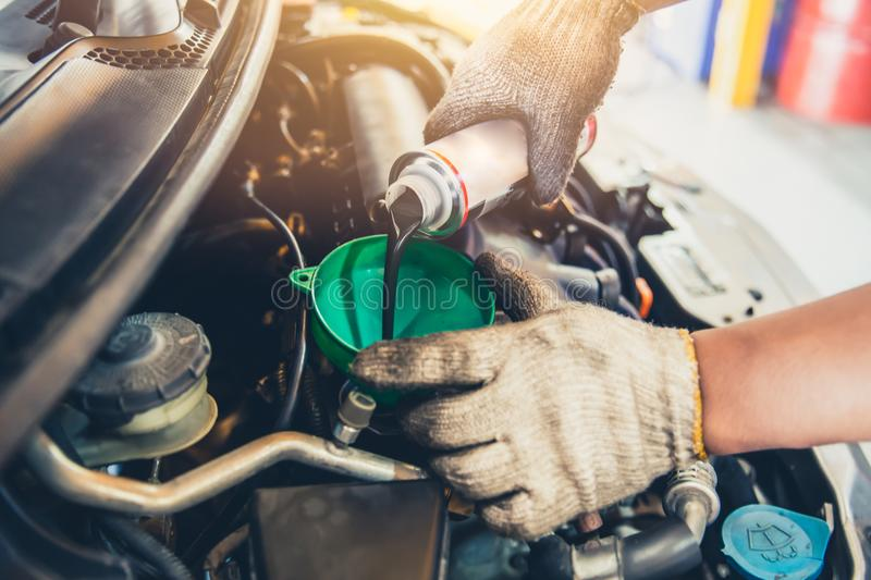 Car maintenance change oil and filling engine lube stock photography