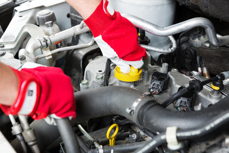 Car maintenance - mechanic check vehicle engine stock photos