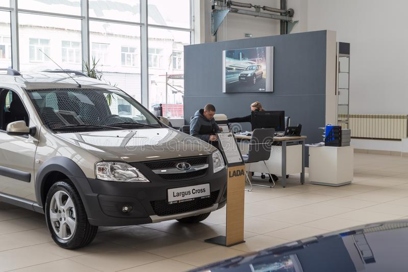 Car, manager and customer in showroom of dealership AVTOVAZ named SeverAvto in Kirov city in 2018. Top view. Kirov, Russia - March 06, 2018: Car, manager and stock photography