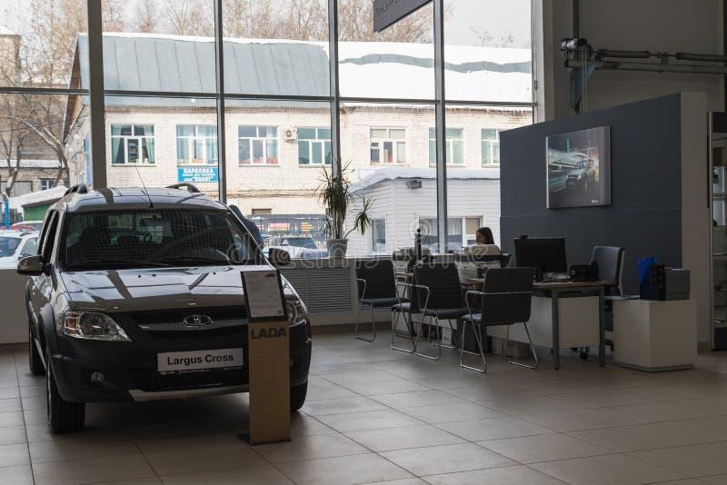 Car and manager in showroom of dealership AVTOVAZ named SeverAvto in Kirov city in 2018. Top view. Kirov, Russia - March 06, 2018: Cars and manager in showroom stock photos