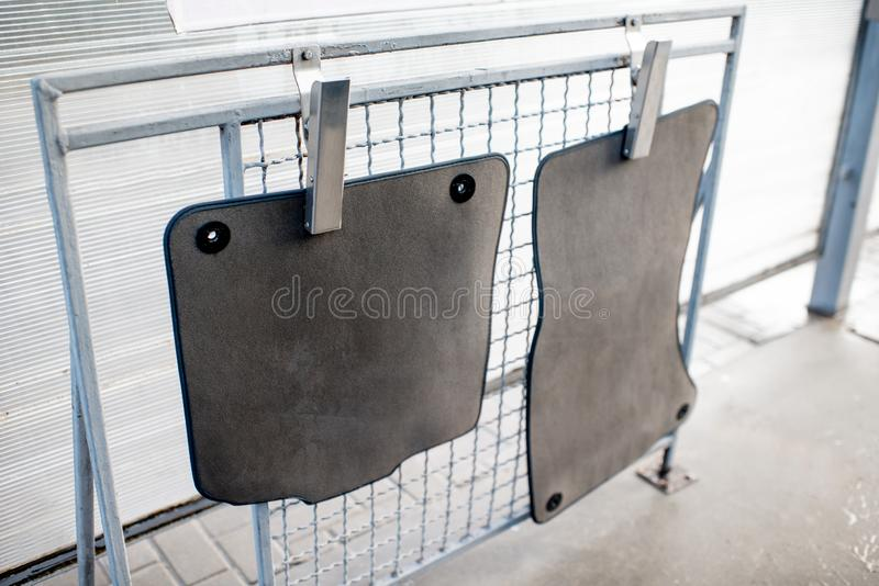 Car mats on a drying net royalty free stock images