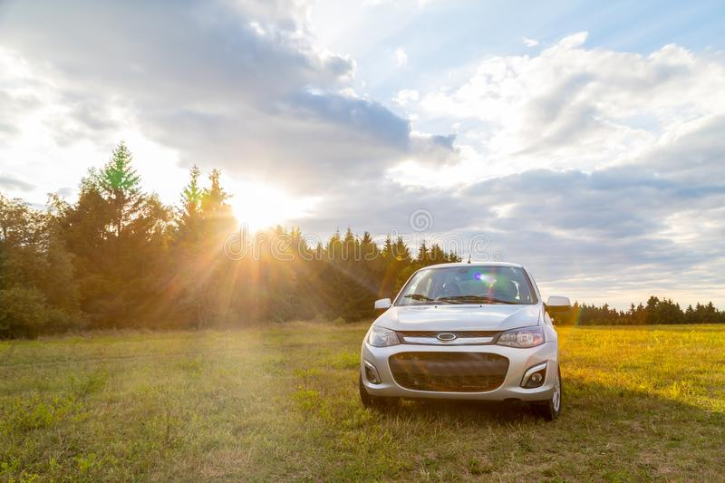Car in the meadow and clouds in the sky on a summer or autumn. Car in the meadow and clouds in the sky in a summer or an autumn day royalty free stock photos