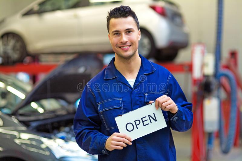 Car mechanic in auto repair shop royalty free stock photo