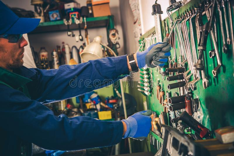 Car Mechanic and His Tools royalty free stock image