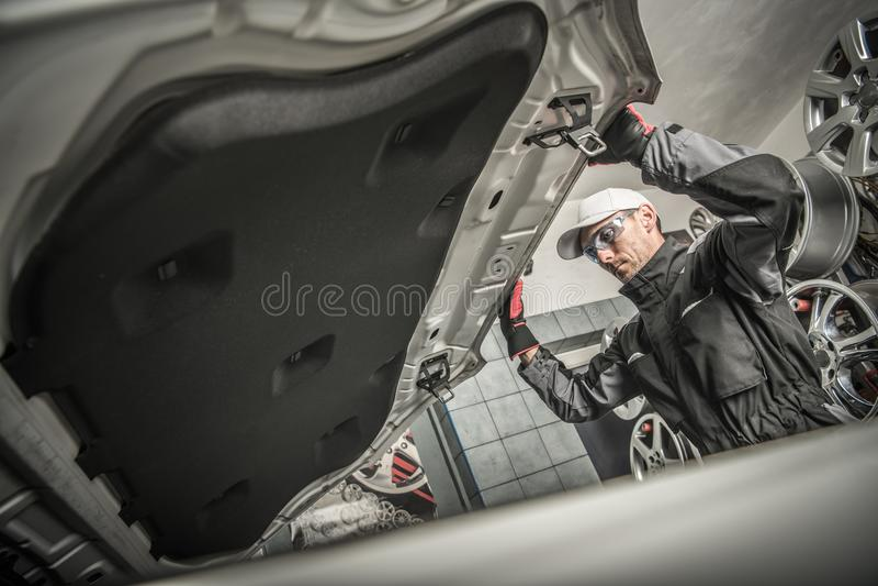 Car Mechanic Opening Hood stock image