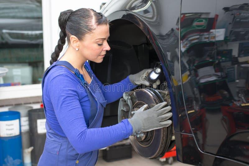 Car mechanic repairs the brakes stock image