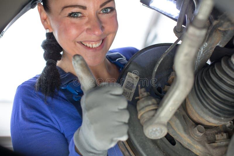 Car mechanic repairs the brakes royalty free stock photos