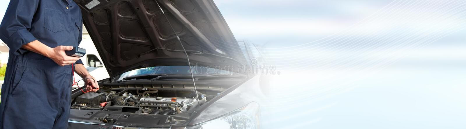 Car mechanic working in auto repair service. royalty free stock photography