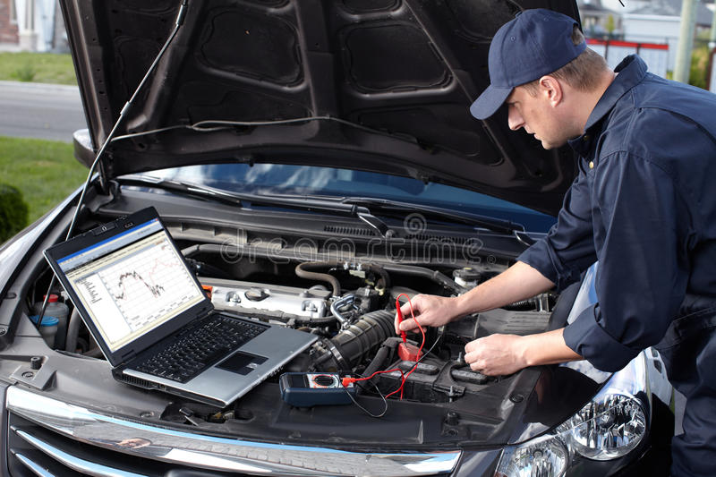 Car mechanic working in auto repair service. royalty free stock photos