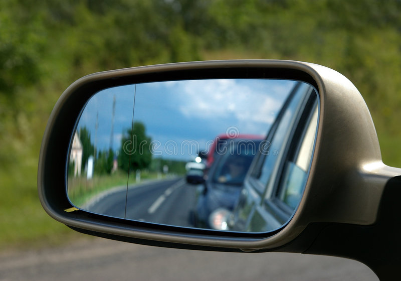 Car mirror. View of the car side mirror royalty free stock image