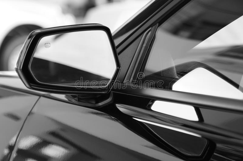 Car mirror. Close up of a side car mirror stock image