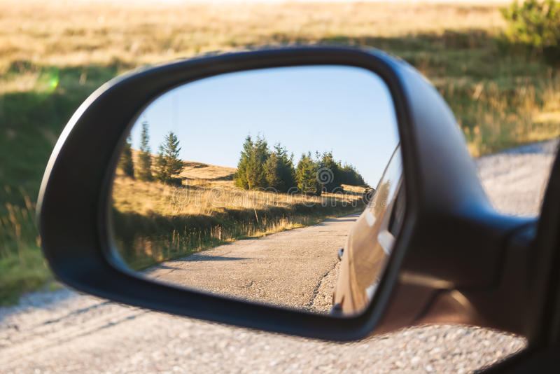 Car mirror. Concept of travel stock photo