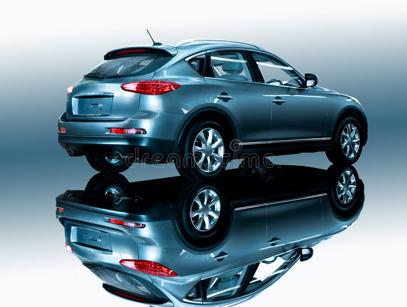 Car on a mirror. Car goes on a mirror. The car is reflected in a mirror. A background white and blue stock images