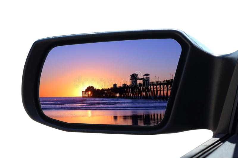 Car Mirror. Sunset at the beach in car rearview mirror stock photo