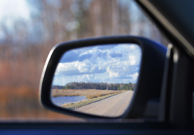 Car mirroring. Nature and blue sky mirroring in car mirror royalty free stock photos