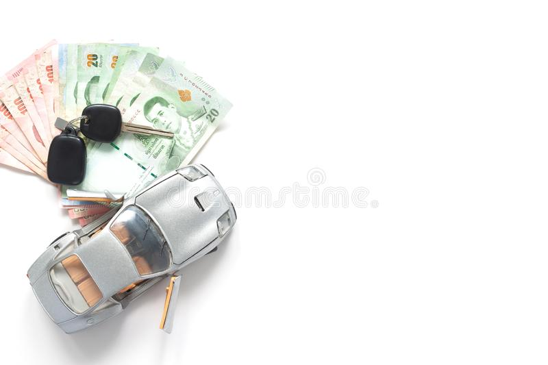 Car model and Thailand currency on white background. Car loan co. Ncept stock photography
