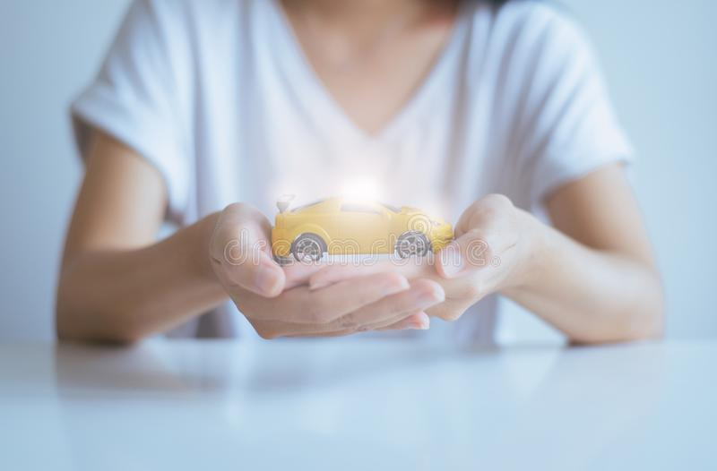 Car model toy on hand,Business and finance concept. Car model toy on hand at office,Business and finance concept royalty free stock images