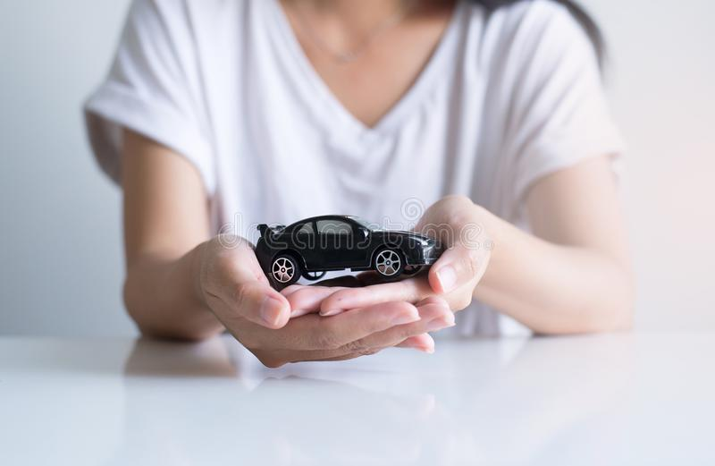 Car model toy on hand,Business and finance concept. Car model toy on hand at office,Business and finance concept stock images
