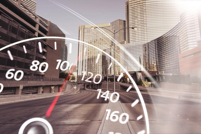 Modern car speedometer on urban city background royalty free stock photography