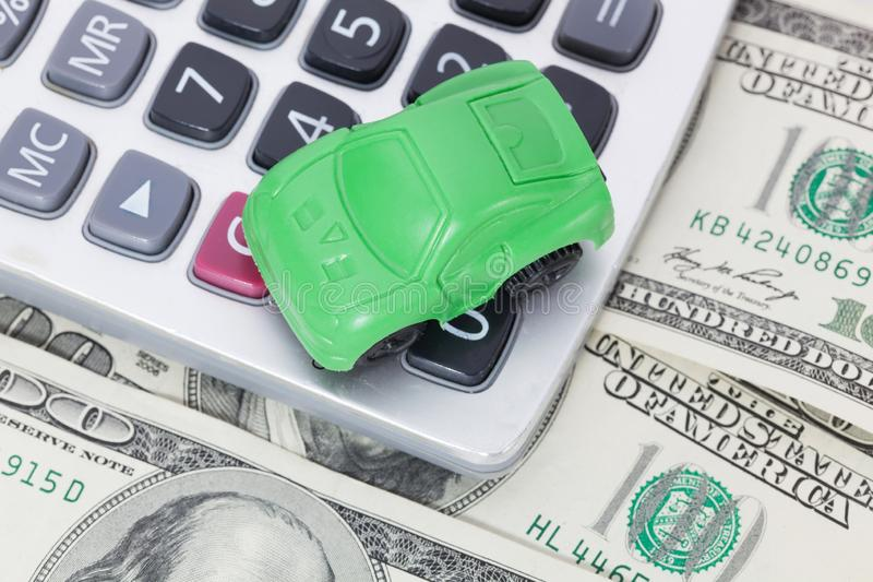 Car money and calculator. Payments and costs. Car money and calculator. Payments and costs royalty free stock photography