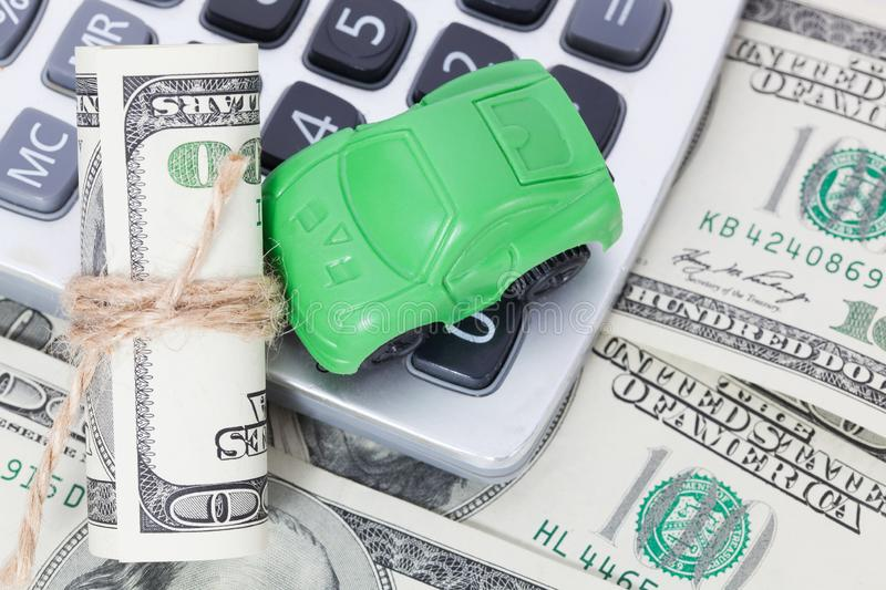 Car money and calculator. Payments and costs. Car money and calculator. Payments and costs royalty free stock photo
