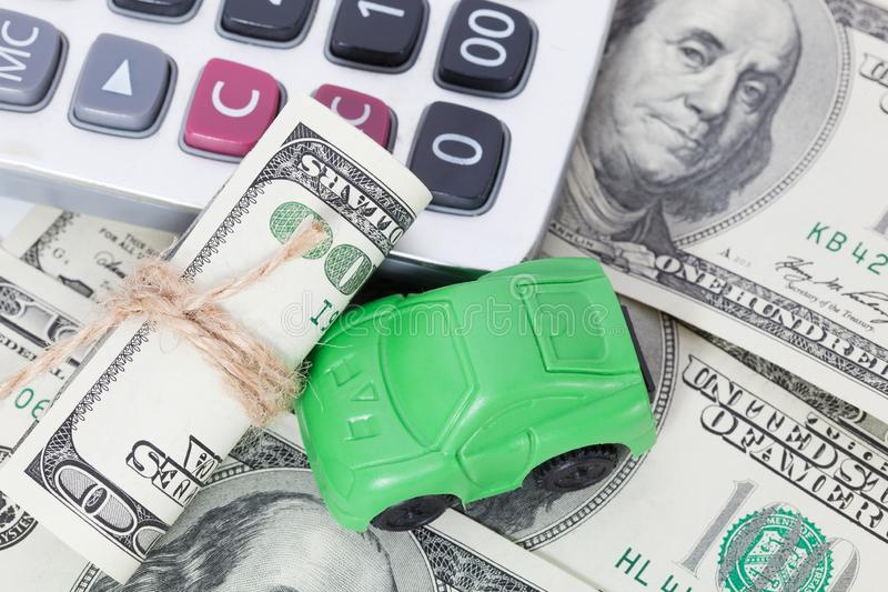 Car money and calculator. Payments and costs. Car money and calculator. Payments and costs stock photo