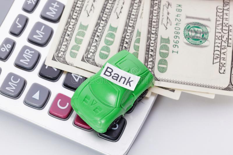 Car money and calculator With sign - Bank. Payments and costs. Car money and calculator With sign - Bank. Payments and costs stock images