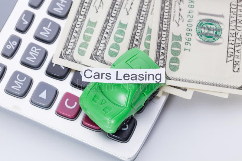 Car money and calculator With sign - Cars Leasing. Payments and costs. Car money and calculator With sign - Cars Leasing. Payments and costs royalty free stock photos