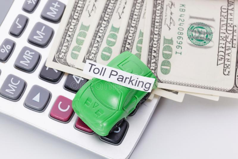 Car money and calculator With sign - Toll Parking. Payments and costs. Car money and calculator With sign - Toll Parking. Payments and costs stock photo
