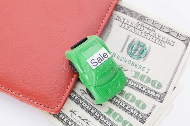 Car money With sign - Sale. Payments and costs. Car money With sign - Sale. Payments and costs royalty free stock photography