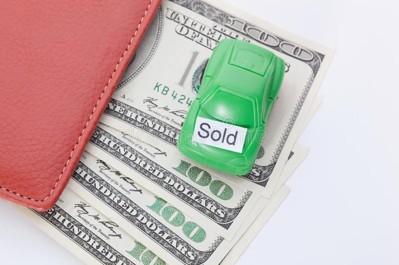 Car money With sign - Sold. Payments and costs. Car money With sign - Sold. Payments and costs stock photos