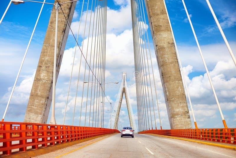 Car is moving through the beautiful bridge. The Francisco del Rosario Sánchez Bridge over the Ozama river in Santo Domingo royalty free stock photo