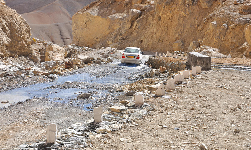 Download Car moving on broken road editorial stock image. Image of water - 20135529