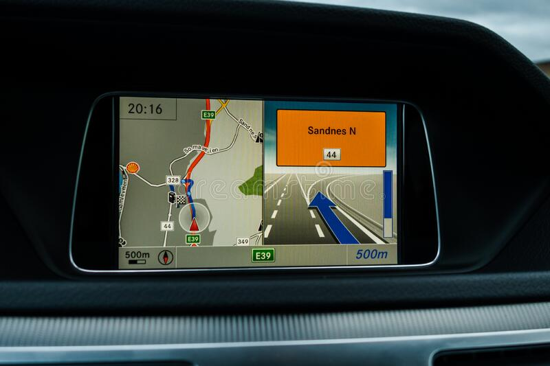 Car navigator display showing to take the next exit to get to Sandnes in Norway. Editorial 09.02.2019 Stavanger Norway Car navigator display showing to take the royalty free stock images