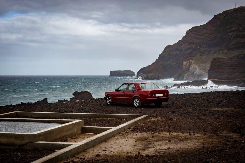 The car near the ocean, rocky coast.  stock photography