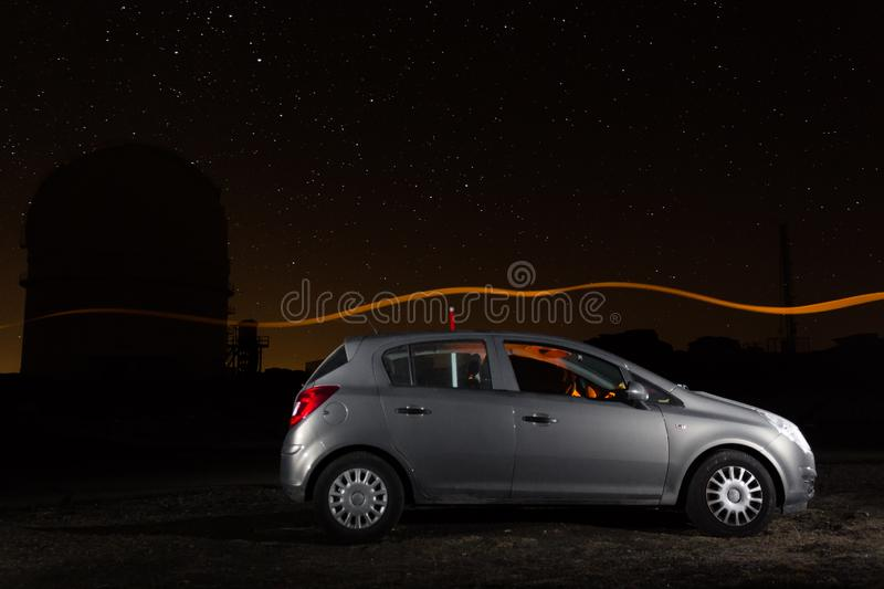 Car and observatory under the stars royalty free stock photography