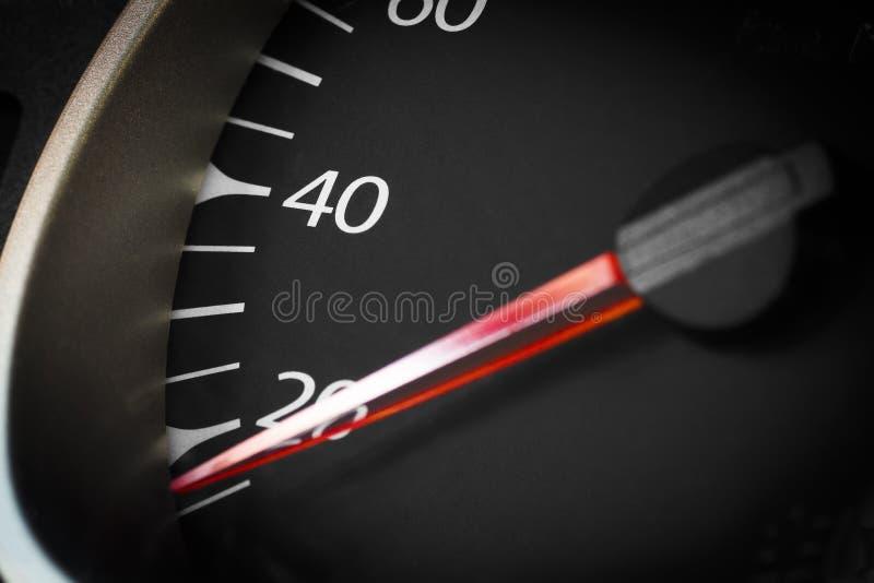 Car odometer closeup. Car odometer with a red arrow closeup royalty free stock images