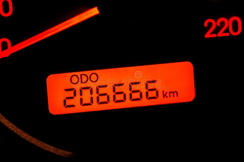 Car odometer reaches a two hundred and six thousand six hundred and sixty-six kilometres.  royalty free stock images