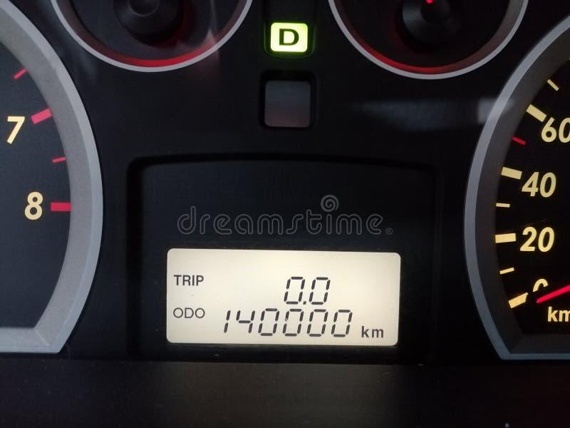 Car odometer reading high number kilometers stock photo