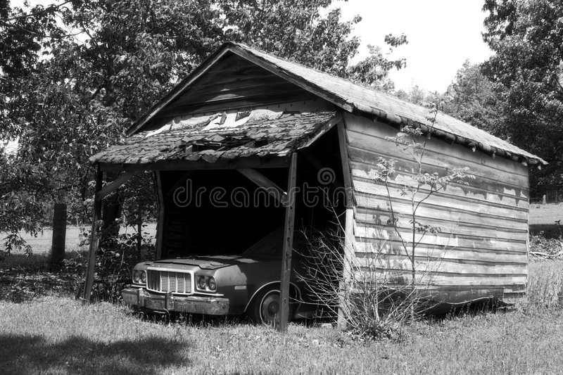 Car in Old Shed royalty free stock images