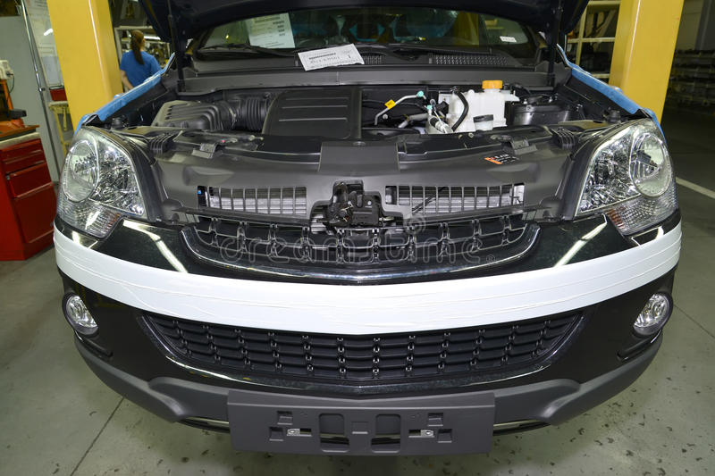 The car with an open cowl costs in assembly shop of automobile p. Lant royalty free stock photo