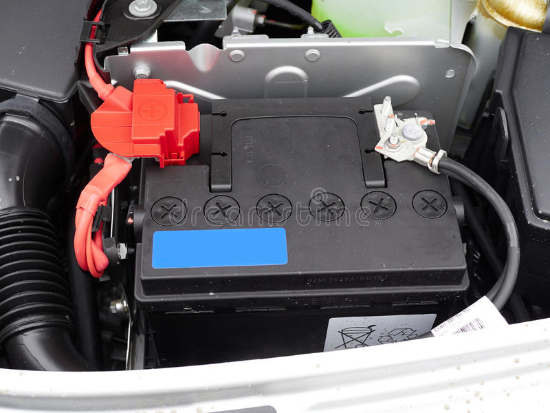 Car with open hood.Battery. Details of new car engine royalty free stock photography